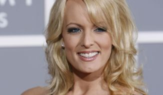 In this Feb. 11, 2007, file photo, Stormy Daniels arrives for the 49th Annual Grammy Awards in Los Angeles. (AP Photo/Matt Sayles)