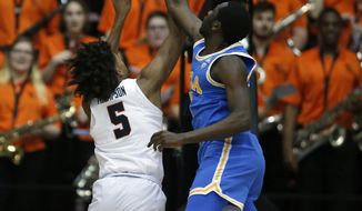 Oregon State's Ethan Thompson (5) has his shot blocked by UCLA's Prince Ali during the first half of an NCAA college basketball game in Corvallis, Ore., Thursday, Jan. 18, 2018. (AP Photo/Timothy J. Gonzalez)
