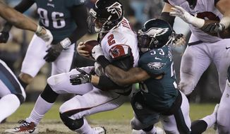 FILE - In this Jan. 13, 2018, file photo, Philadelphia Eagles' Nigel Bradham (53) tackles Atlanta Falcons' Matt Ryan (2) during an NFL divisional playoff football game, in Philadelphia. One team has a suffocating defense. The other has the NFL's No. 1 unit. Defense should win at least the NFC championship. (AP Photo/Matt Rourke, File)