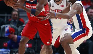 Washington Wizards guard Jodie Meeks, left,passes around Detroit Pistons guard Langston Galloway during the first half of an NBA basketball game, Friday, Jan. 19, 2018, in Detroit. (AP Photo/Carlos Osorio)