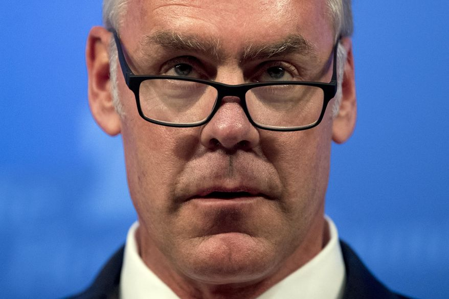 FILE - In this Sept. 29, 2017 file photo, Interior Secretary Ryan Zinke speaks on the Trump Administration's energy policy at the Heritage Foundation in Washington. Zinke has presided over a year of bureaucratic upheaval at the Interior Department that has seen dozens of senior staff re-assigned, key leadership positions go unfilled, rules governing industry shelved and a mass resignation from a National Park system advisory board. (AP Photo/Andrew Harnik, File)