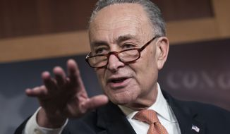 Senate Minority Leader Chuck Schumer, D-N.Y., explains to reporters how his negotiations with President Donald Trump broke down yesterday as quarreling politicians in Washington eventually failed to keep their government in business, at the Capitol in Washington, Saturday, Jan. 20, 2018. (AP Photo/J. Scott Applewhite)