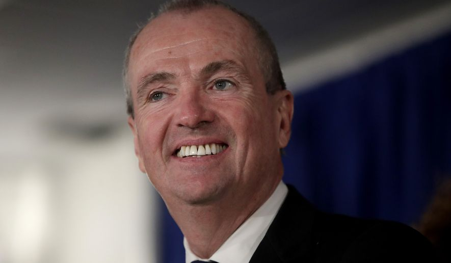 FILE - In this Jan. 16,2018 file photo, New Jersey Gov. Phil Murphy speaks before signing the first executive order of his administration in Trenton, N.J.  Funding for women's health and pay equity legislation will be the first bills Murphy pushes for, he said soon after taking over for Republican Chris Christie.  (AP Photo/Julio Cortez, File)