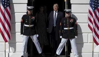 President Donald Trump and first lady Melania Trump walk from the White House in Washington, Monday, Oct. 2, 2017, to the South Lawn for a moment of silence to remember the victims of the mass shooting in Las Vegas. (AP Photo/Carolyn Kaster, File)