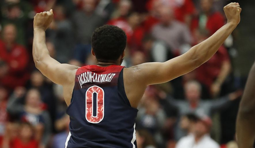 Arizona guard Parker Jackson-Cartwright (0) celebrates after a  victory against Stanford in an NCAA college basketball game Saturday, Jan. 20, 2018, in Stanford, Calif. (AP Photo/Tony Avelar)