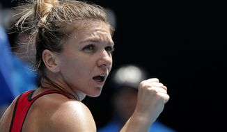 Romania's Simona Halep celebrates after defeating United States' Lauren Davis in their third round match at the Australian Open tennis championships in Melbourne, Australia, Saturday, Jan. 20, 2018. (AP Photo/Vincent Thian)