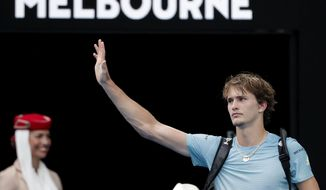 Germany's Alexander Zverev waves as he leaves Rod Laver Arena after losing his third round to South Korea's Chung Hyeon at the Australian Open tennis championships in Melbourne, Australia, Saturday, Jan. 20, 2018. (AP Photo/Vincent Thian)