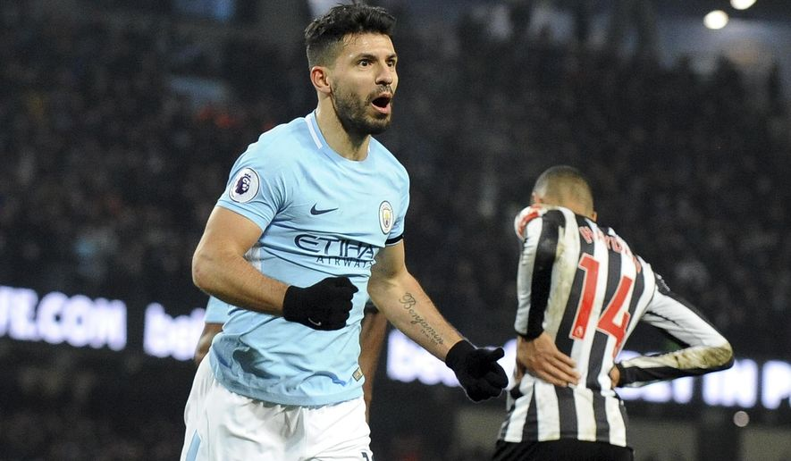 Manchester City's Sergio Aguero celebrates after scoring his side's third goal during the English Premier League soccer match between Manchester City and Newcastle United at the Etihad Stadium in Manchester, England, Saturday, Jan. 20, 2018. (AP Photo/Rui Vieira)