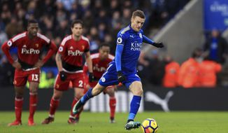 Leicester City's Jamie Vardy scores his side's first goal of the game, during the English Premier League match between Leicester City and Watford, at the King Power Stadium, in Leicester, England, Saturday, Jan. 20, 2018. (Mike Egerton/PA via AP)