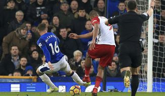 Everton's James McCarthy, left, gets injured after attempting to block a shot from West Bromwich Albion's Salomon Rondon  during their English Premier League soccer match at Goodison Park, Liverpool, England, Saturday, Jan. 20, 2018. (Peter Byrne/PA via AP)
