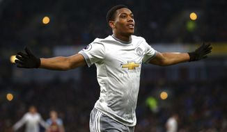 Manchester United's Anthony Martial celebrates scoring his side's first goal of the game during their English Premier League soccer match against Burnley at Turf Moor, Burnley, England, Saturday, Jan. 20, 2018. (Dave Thompson/PA via AP)