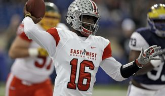 East quarterback JT Barrett (16), of Ohio State, throws a pass against the West during the first half of the East West Shrine football game Saturday, Jan. 20, 2018, in St. Petersburg, Fla. (AP Photo/Chris O'Meara)