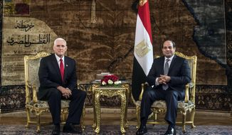 U.S. Vice President Mike Pence meets with Egyptian President Abdel-Fattah el-Sissi, right, at the Presidential Palace in Cairo, Egypt, Saturday, Jan. 20, 2018. Pence arrived in Cairo hours after the U.S. Congress and President Donald Trump failed to reach agreement on a plan to avert a partial federal closure. Pence went ahead with his four-day trip to the Middle East, citing national security and diplomatic reasons. (Khaled Desouki/Pool Photo via AP)