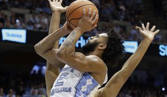 North Carolina's Joel Berry II (2) drives to the basket while Georgia Tech's Brandon Alston defends during the first half of an NCAA college basketball game in Chapel Hill, N.C., Saturday, Jan. 20, 2018. (AP Photo/Gerry Broome)