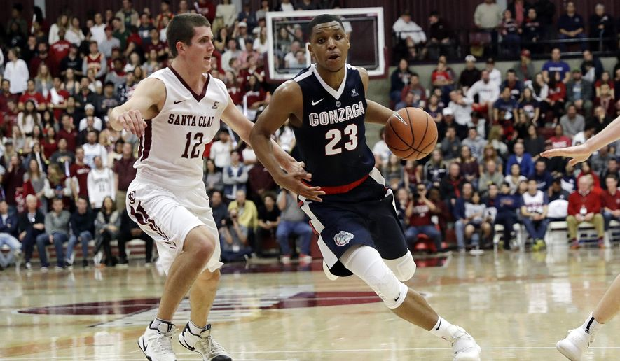 Gonzaga guard Zach Norvell Jr. (23) dribbles next to Santa Clara guard Matt Hauser (12) during the second half of an NCAA college basketball game Saturday, Jan. 20, 2018, in Santa Clara, Calif. (AP Photo/Marcio Jose Sanchez)