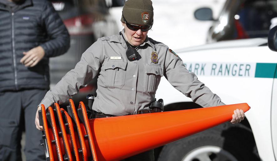 Rocky Mountain National Park Ranger Amy Fink and other critical staff members continued to work as open-air national parks and monuments remained open to visitors during the government shutdown. (Associated Press)