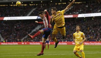Atletico Madrid's Kevin Gameiro, left, goes for a header with Girona's Bernardo Espinosa during a Spanish La Liga soccer match between Atletico Madrid and Girona at the Wanda Metropolitano stadium in Madrid, Saturday, Jan. 20, 2018. The match ended in a 1-1 draw. (AP Photo/Francisco Seco)
