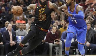 Cleveland Cavaliers' LeBron James (23) drives against Oklahoma City Thunder's Paul George (13) in the first half of an NBA basketball game, Saturday, Jan. 20, 2018, in Cleveland. (AP Photo/Tony Dejak)