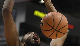 Villanova's Mikal Bridges reacts as he dunks the ball during the first half of an NCAA college basketball game agains Connecticut, Saturday, Jan. 20, 2018, in Hartford, Conn. (AP Photo/Jessica Hill)