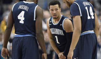 Villanova's Jalen Brunson, center, talks with teammates Eric Paschall, left, and Omari Spellman, right, during the first half of an NCAA college basketball game, Saturday, Jan. 20, 2018, in Hartford, Conn. (AP Photo/Jessica Hill)