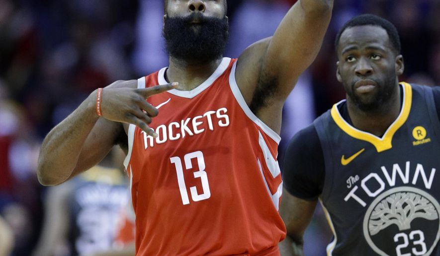 Houston Rockets guard James Harden (13) celebrates a three point shot as Golden State Warriors forward Draymond Green (23) looks on during the first half of an NBA basketball game Saturday, Jan. 20, 2018, in Houston. (AP Photo/Michael Wyke)