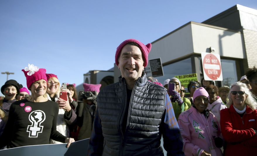 Gov. Ralph Northam attends the Women's March in Richmond, Va.,  on Saturday Jan. 20, 2018.  People participating in marches in the U.S. and around the world are walking in support of female empowerment and are denouncing President Donald Trump's views on immigration, abortion, LGBT and women's rights and more. (Shelby Lum/Richmond Times-Dispatch via AP)