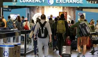 "Among the findings of the new report were the White House short-circuited the usual full legal review from the Justice Department and it didn't provide the final order to agencies that had to carry out the travel ban until two hours after President Trump signed it. Travelers walk toward a currency exchange at the Seattle-Tacoma International Airport, Monday, June 26, 2017, in Seattle. The U.S. Supreme Court said Monday that President Donald Trump's travel ban on visitors from Iran, Libya, Somalia, Sudan, Syria and Yemen can be enforced if those visitors lack a ""credible claim of a bona fide relationship with a person or entity in the United States,"" and that justices will hear full arguments in October 2017. (AP Photo/Ted S. Warren) (Associated Press)"