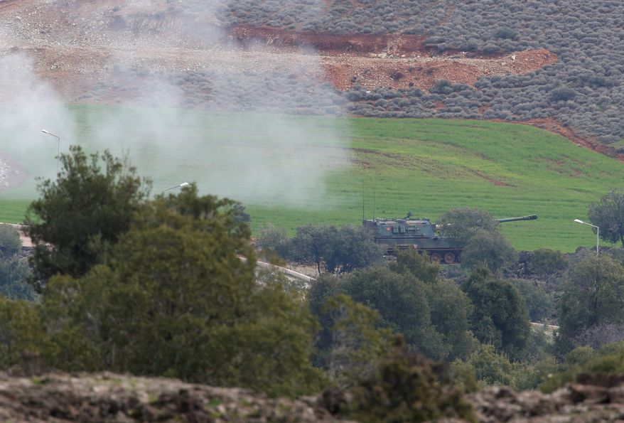 Turkish Army artillery fire towards Syria as seen from the outskirts of the village of Sugedigi, Turkey, near the border with Syria, Sunday, Jan. 21, 2018. Turkey's ground troops entered the enclave of Afrin, in northern Syria on Sunday and were advancing with Turkish-backed Syrian opposition forces in their bid to oust Syrian Kurdish forces from the region. AP Photo/Lefteris Pitarakis) (ASSOCIATED PRESS PHOTOHGRAPHS)