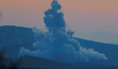 """LEFT: Military aircraft flies over Syria as seen from the outskirts of the border town of Kilis, Turkey, on Saturday. Turkish jets have begun an aerial offensive, code-named operation """"Olive Branch"""", against the Syrian Kurdish-held enclave of Afrin, in northwest Syria. RIGHT: Plumes of smoke rise on the air from inside Syria. A military statement says the operation launched Saturday aims to protect Turkey's borders. (ASSOCIATED PRESS PHOTGRAPHS)"""