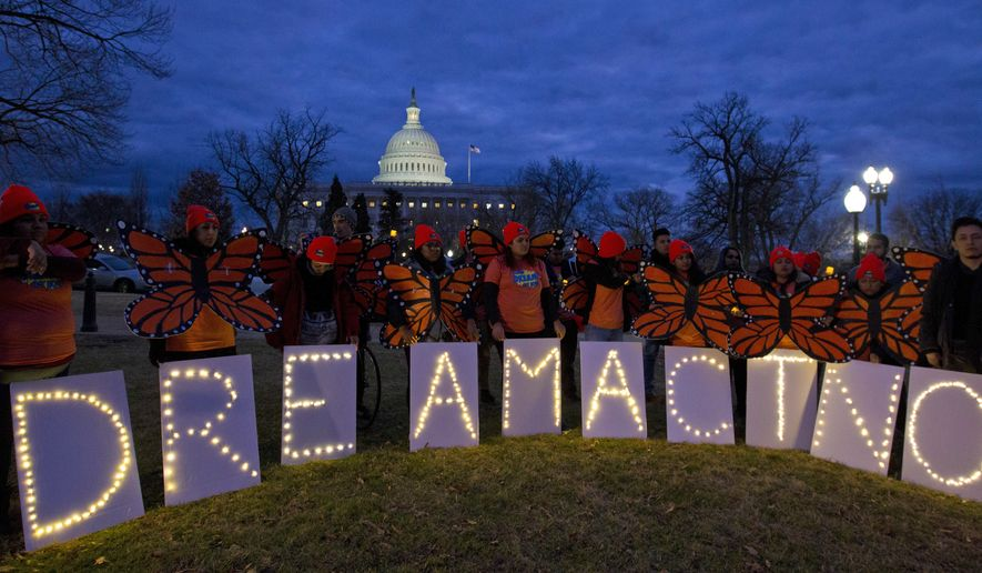 Demonstrators rally in support of Deferred Action for Childhood Arrivals (DACA) outside the Capitol, Sunday, Jan. 21, 2018, in Washington. (AP Photo/Jose Luis Magana) ** FILE **