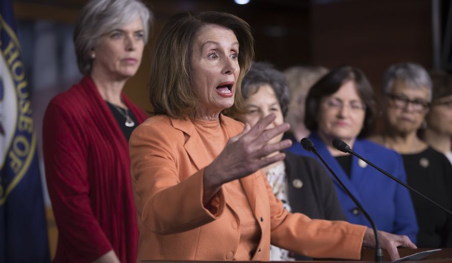 House Minority Leader Nancy Pelosi, D-Calif., leads a news conference of female Democrats on Day 2 of the federal shutdown at the Capitol in Washington, Sunday, Jan. 21, 2018. (AP Photo/J. Scott Applewhite)