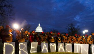 "Demonstrators rally in support of Deferred Action for Childhood Arrivals (DACA) outside the Capitol, Sunday, Jan. 21, 2018, in Washington, on the second day of the federal shutdown. Democrats have been seeking a deal to protect the ""Dreamers,"" who have been shielded against deportation by DACA, which President Donald Trump halted last year. (AP Photo/Jose Luis Magana) **FILE**"