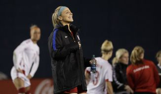 United States midfielder Julie Ertz dances after defeating Denmark in an international friendly soccer match Sunday, Jan. 21, 2018, in San Diego. (AP Photo/Gregory Bull)