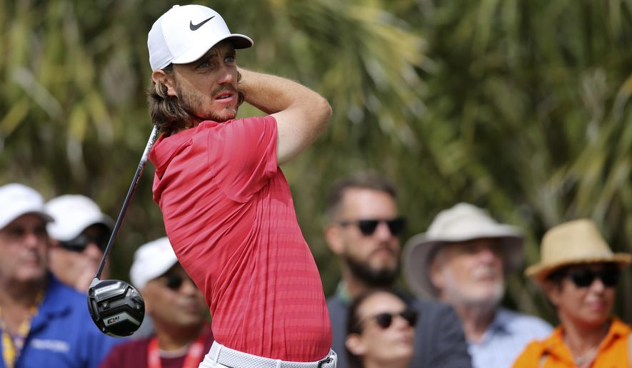 England's Tommy Fleetwood tees off on the 2nd hole during the final round of the Abu Dhabi Championship golf tournament in Abu Dhabi, United Arab Emirates, Sunday, Jan. 21, 2018. (AP Photo/Kamran Jebreili)