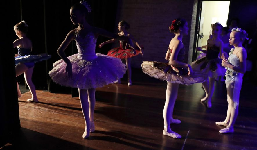 Young ballet dancers warm up for the Youth America Grand Prix regional semifinals at Dominican University Performing Arts Center in River Forest, Ill., Friday, Jan. 19, 2018. The organization awards more than $250,000 a year in scholarships to send young dancers to leading schools and dance companies to continue their training. (AP photo/Nam Y. Huh)