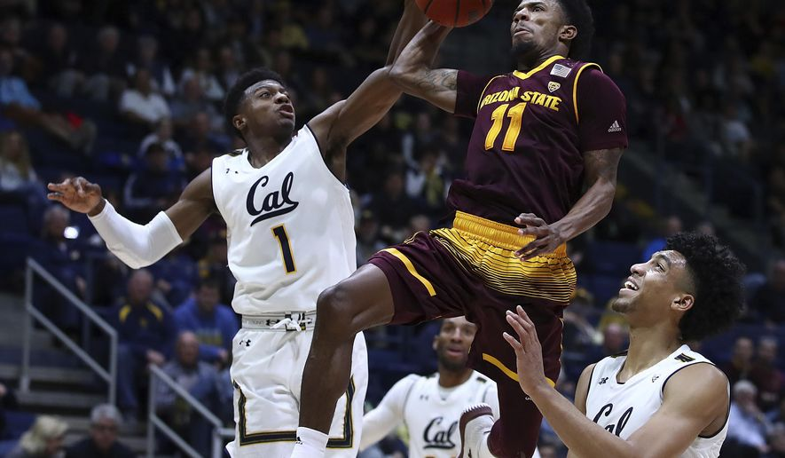 Arizona State's Shannon Evans II (11) shoots between California's Darius McNeill, left, and Justice Sueing during the second half of an NCAA college basketball game Saturday, Jan. 20, 2018, in Berkeley, Calif. (AP Photo/Ben Margot)