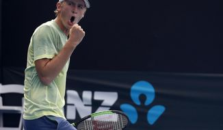 United States' Sebastian Korda celebrates after defeating France's Clement Tabur in their boy's singles match at the Australian Open tennis championships in Melbourne, Australia, Sunday, Jan. 21, 2018. Sebastian, the son of 1998 Australian Open champion Petr Korda, got his own debut Australian Open campaign off to a promising start, however, winning his opening matches in both the boys' singles and doubles competitions on Sunday.(AP Photo/Ng Han Guan)