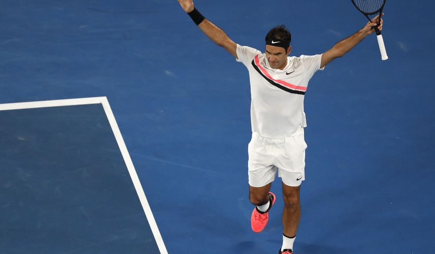 Switzerland's Roger Federer celebrates after defeating France's Richard Gasquet in their third round match at the Australian Open tennis championships in Melbourne, Australia, Saturday, Jan. 20, 2018. (AP Photo/Ng Han Guan)