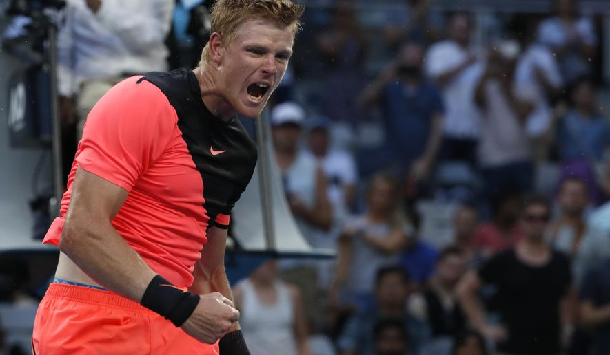 Britain's Kyle Edmund celebrates after defeating Italy's Andreas Seppi in their fourth round match at the Australian Open tennis championships in Melbourne, Australia Sunday, Jan. 21, 2018. (AP Photo/Ng Han Guan)