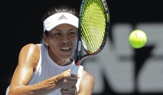 Taiwan's Hsieh Su-wei makes a backhand return to Germany's Angelique Kerber during their fourth round match at the Australian Open tennis championships in Melbourne, Australia, Monday, Jan. 22, 2018. (AP Photo/Dita Alangkara)