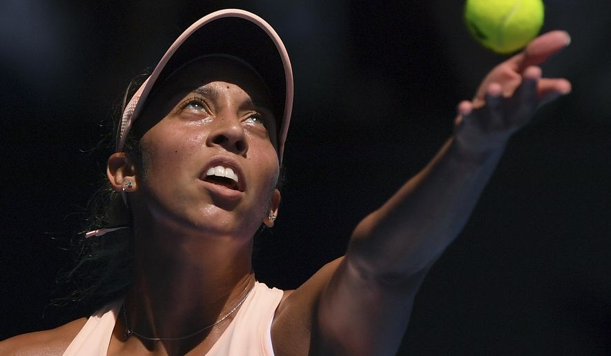 United States' Madison Keys serves to France's Caroline Garcia during their fourth round match at the Australian Open tennis championships in Melbourne, Australia, Monday, Jan. 22, 2018. (AP Photo/Andy Brownbill)