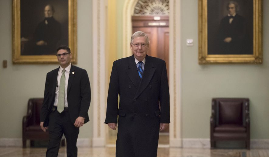 Senate Majority Leader Mitch McConnell, R-Ky., returns to his office as the federal shutdown enters Day 2 amid a partisan blame game on both sides, at the Capitol in Washington, Sunday, Jan. 21, 2018. (AP Photo/J. Scott Applewhite)