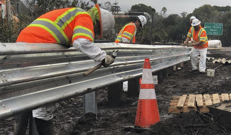 In this Friday, Jan. 19, 2018 photo, Caltrans workers continue their around-the-clock efforts Friday to clean-up and repair the damaged section of US 101 in Montecito, Calif., that was closed following flooding on Jan. 9. California officials say key coastal highway swamped by deadly mudslides has reopened Sunday, Jan 21, 2018, after nearly 2-week closure. (Mike Eliason/Santa Barbara County Fire Department via AP, File)