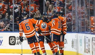 Edmonton Oilers celebrate a goal by Jujhar Khaira (16) against the Vancouver Canucks during the first period of an NHL hockey game Saturday, Jan. 20, 2018, in Edmonton, Alberta. (Jason Franson/The Canadian Press via AP)