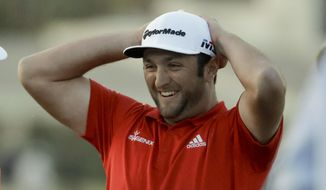 Jon Rahm celebrates after winning the CareerBuilder Challenge golf tournament on the Stadium Course at PGA West Sunday, Jan. 21, 2018 in La Quinta, Calif. (AP Photo/Chris Carlson)