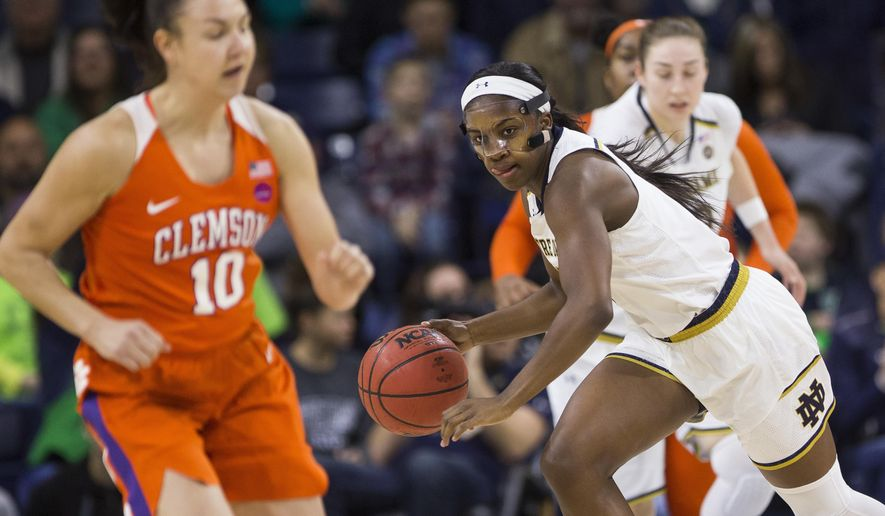 Notre Dame's Jackie Young, right, drives downcourt near Clemson's Francesca Tagliapietra (10) during the first half of an NCAA college basketball game Sunday, Jan. 21, 2018, in South Bend, Ind. (AP Photo/Robert Franklin)