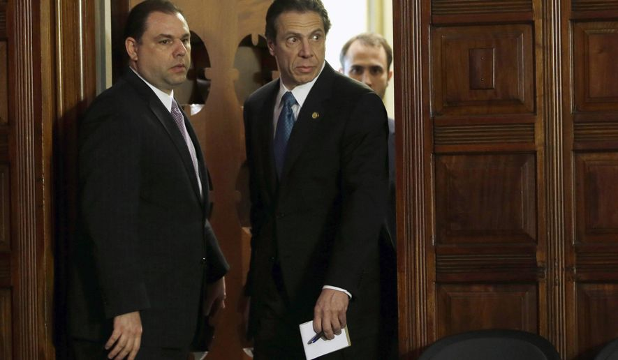 FILE - In this April 26, 2013, file photo, New York Gov. Andrew Cuomo, right, and Joseph Percoco, executive deputy secretary, stand at a news conference in Albany, N.Y. Percoco is set to go on trial in New York, Monday, Jan. 22, 2018, on charges that he orchestrated a complicated bribery and extortion scheme involving deep pocketed lobbyists and developers. (AP Photo/Mike Groll, File)