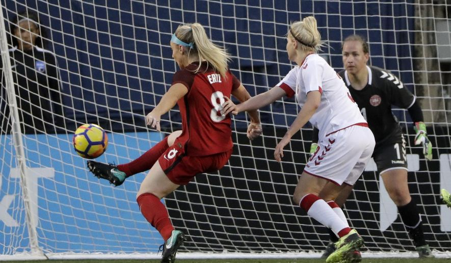 The United States' Julie Ertz, left, knocks the ball over Denmark goalkeeper Stina Lykke Petersen, right, for a goal during the first half of an international friendly soccer match Sunday, Jan. 21, 2018, in San Diego. (AP Photo/Gregory Bull)