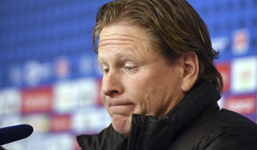 In this photo taken Saturday, Jan. 20, 2018 Hamburg's coach Markus Gisdol grimaces after the Bundesliga soccer match between Hamburger SV and 1. FC Cologne in Hamburg, Germany. (Daniel Reinhardt/dpa via AP)