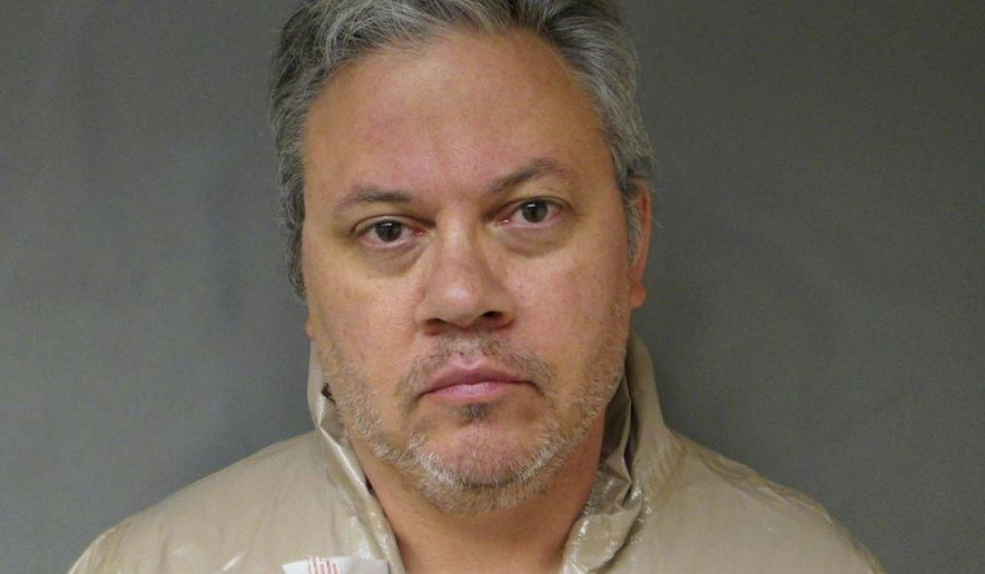 FILE - This Sept. 12, 2017, file booking photo provided by the Lebanon Police Department shows Travis Frink, charged with first-degree murder in the death of his 70-year-old mother, Pamela Ferriere, shot to death in the intensive care unit at Dartmouth-Hitchcock Medical Center in Lebanon, N.H. A preliminary hearing is set for Monday, Jan. 22, 2018,  for Frink of Warwick, Rhode Island. (Lebanon Police Department via AP, File)
